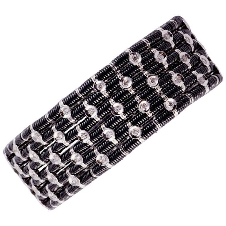 Striking Black Ceramic, 18 Karat White Gold and Diamond Stretch Bracelet For Sale