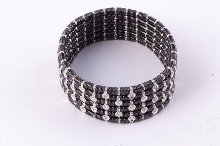 Black Ceramic, White Gold and Diamond Flexible Bracelet containing 1.50 Carats White Full Cut Diamonds-VS clarity