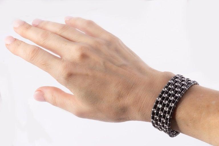 Modern Striking Black Ceramic, 18 Karat White Gold and Diamond Stretch Bracelet For Sale