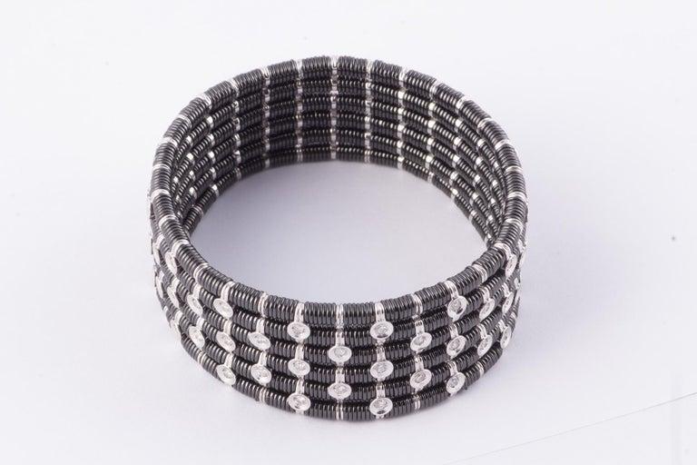 Mixed Cut Striking Black Ceramic, 18 Karat White Gold and Diamond Stretch Bracelet For Sale