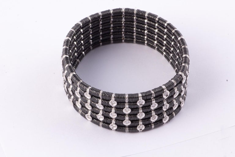 Striking Black Ceramic, 18 Karat White Gold and Diamond Stretch Bracelet In Excellent Condition For Sale In New Orleans, LA