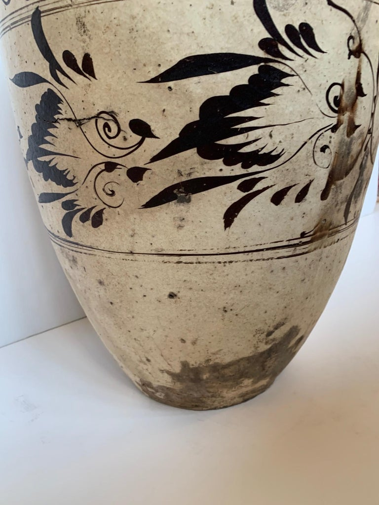 A striking white and black 18th century quite large Cizhou stoneware vessel. Top opening 3.25