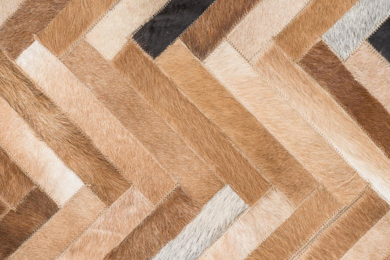 Herringbone pattern brown, white and black De Los Bosques Cowhide Area Floor Rug For Sale 1