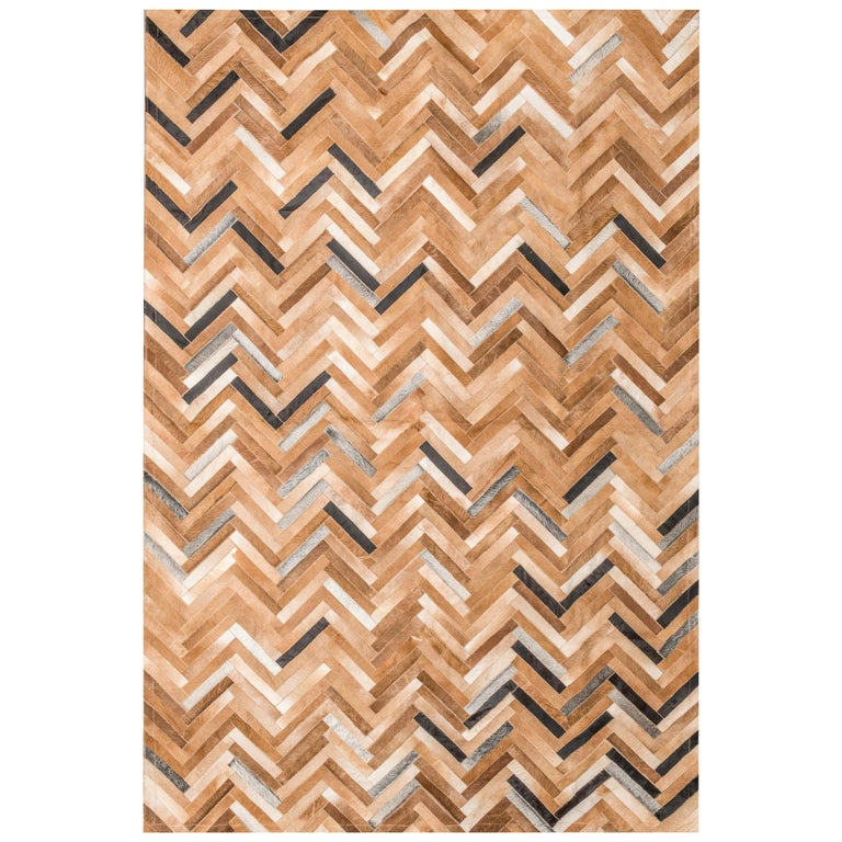 Herringbone pattern brown, white and black De Los Bosques Cowhide Area Floor Rug For Sale