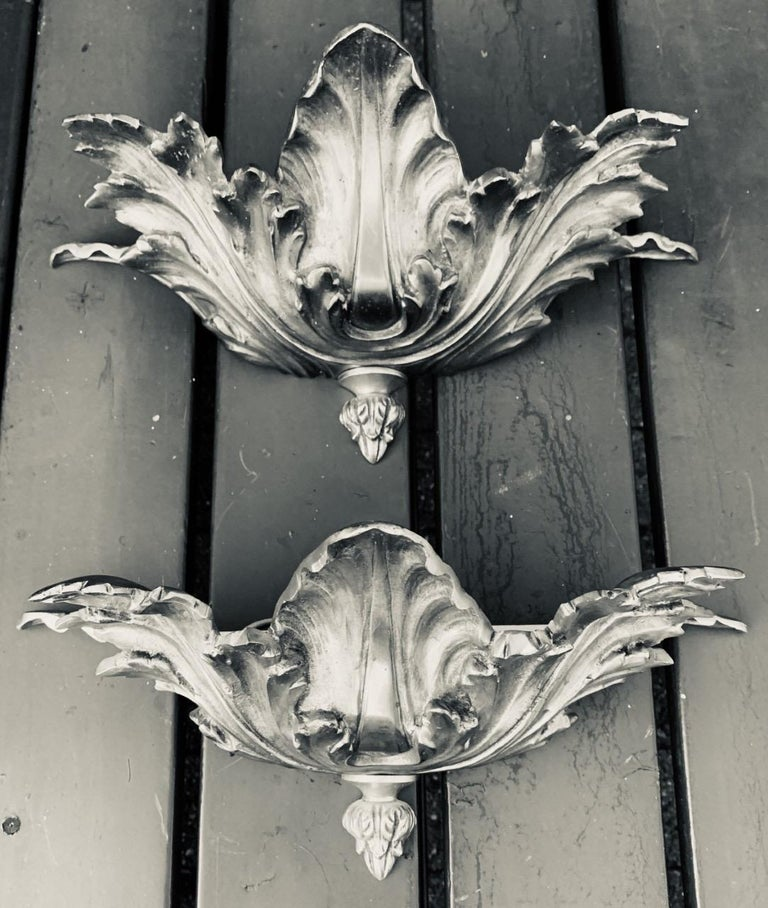 Marvelous set of Hollywood Regency wall lights.  If you are looking for great quality and stylish wall lights to grace your living space then this bronze pair could be your ideal lighting solution. Because of the vibrant designs and the excellent