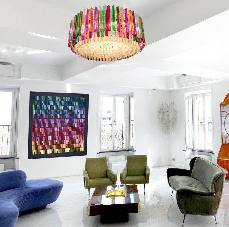 Fabulous Murano glass chandelier with 265 multicolor triedri on chrome frame.   Listing price each 9500$ Dimensions: 43.30 inches (110 cm) height with chain; 15.75 inches (40 cm) height without chain; 29.50 inches (75 cm) diameter. (The