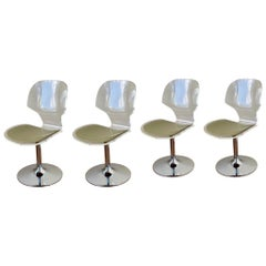 Striking Set of 4 Space Age Lucite and Chrome Swivel Chairs