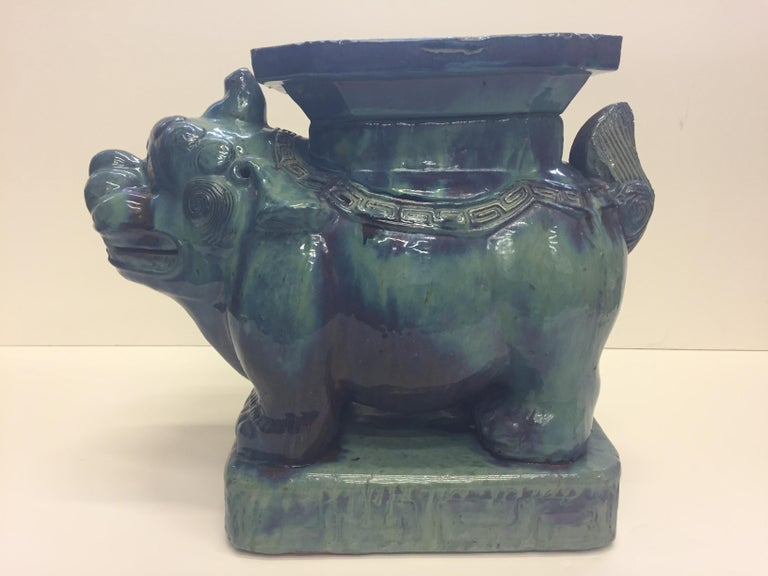 A great looking Asian muted turquoise glazed ceramic garden seat with foo dog motife.