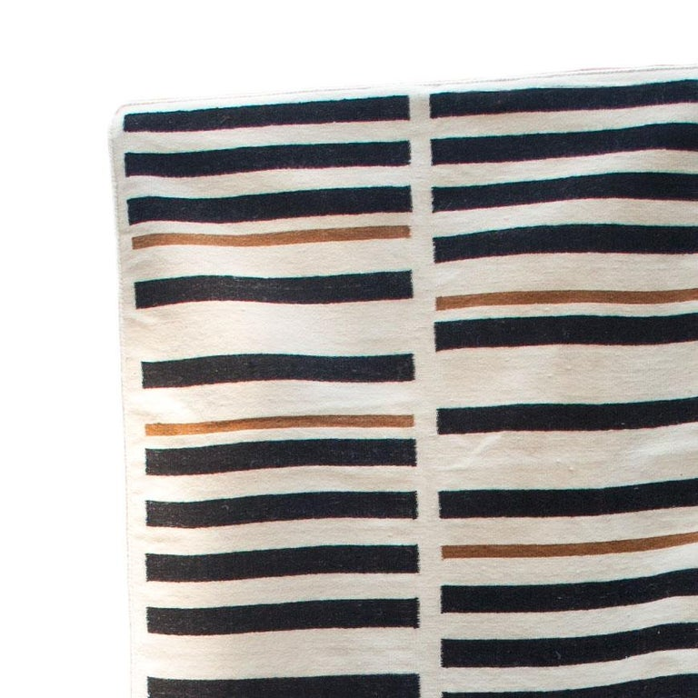This rug has been handwoven in the finest wool yarns by artisans in Rajasthan, India, using a traditional weaving technique which is native to this region.  The purchase of this handcrafted rug helps to support the artisans and preserve their