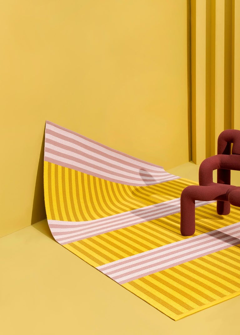 Using Kasthall's new online rug designer tool, Sight Unseen has designed two, limited-edition area rugs. This rectangular woven rug uses a Scandinavian-inspired pastel palette, with tonal variations of pink and mustard inspired by the trompe l'oeil