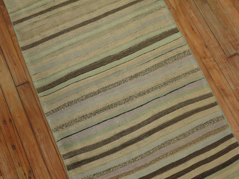 Colorful casual long Kilim runner from the mid-20th century. Mint green, creams, soft blue, lavenders. Measures: 2'5'' x 24'2''.