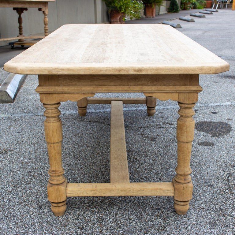 Stripped Antique French Oak Table with Hand Carved Details In Good Condition For Sale In Houston, TX