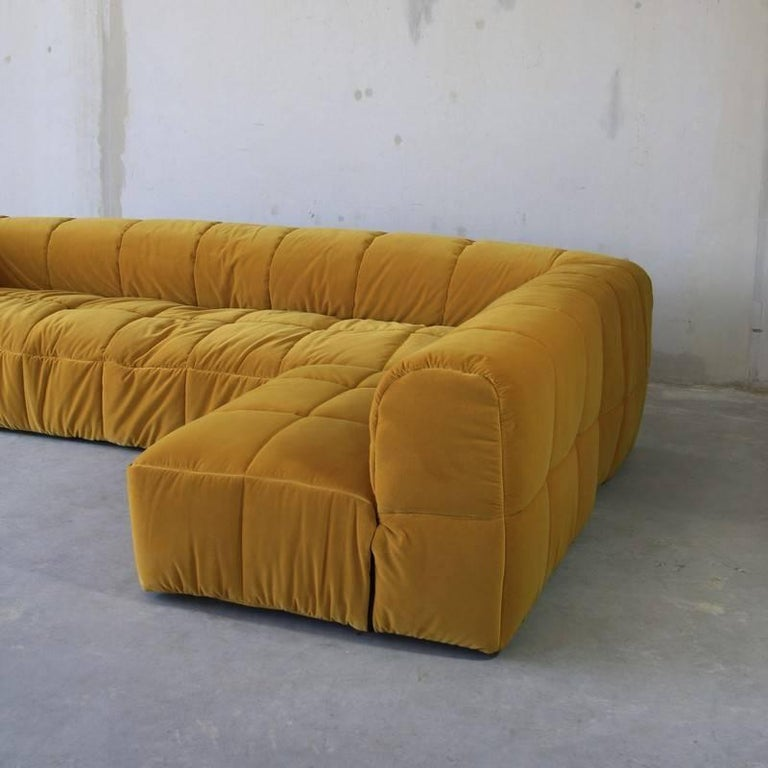Strips sofa unit with removable quilted cover designed by Cini Boeri for Arflex. Designed in 1968, it awarded the prize Compasso d'Oro and it is displayed in several museums in the world such as the MoMA in New York.  Its modularity allows never