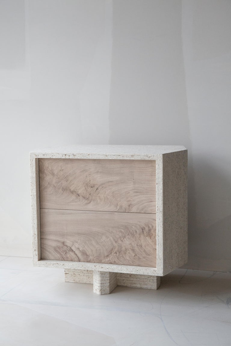 Brutalist and modern architecturally inspired side table or nightstand is available with a floor base or wall mountable without base. Each table is fabricated by hand and available to order in a combination of finish options. Inner drawer portholes