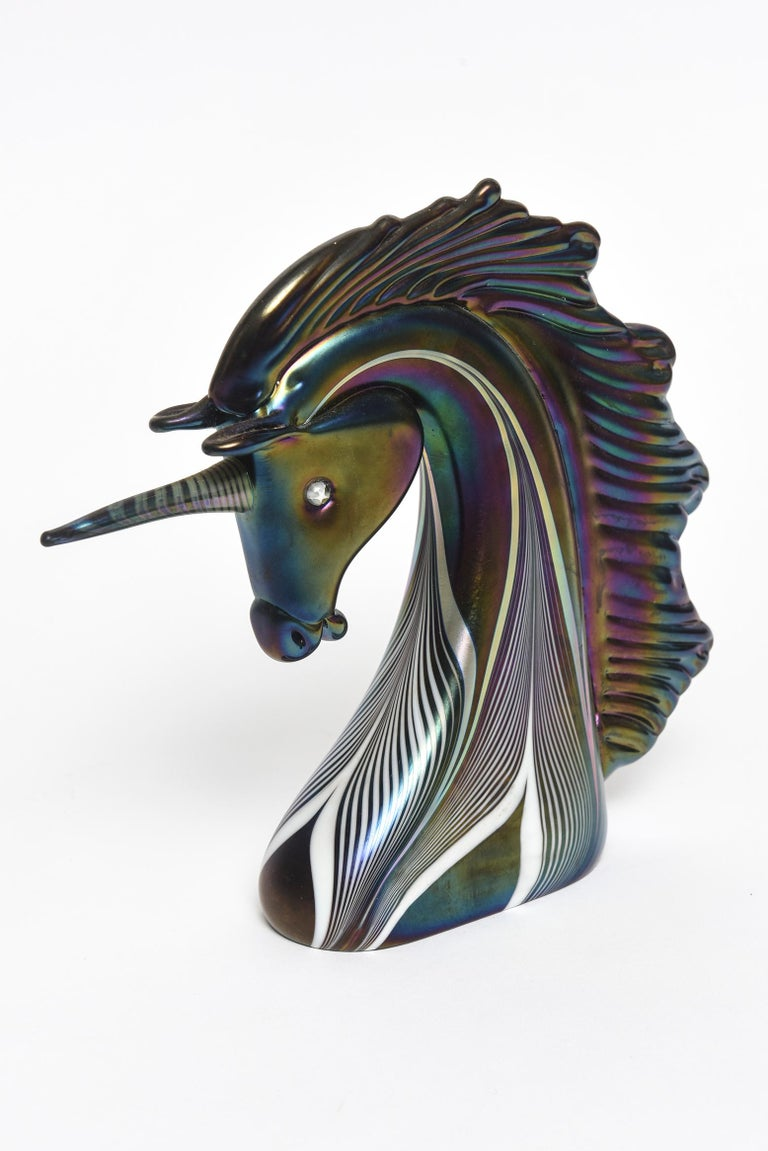 Beautiful art glass unicorn bust by Stuart Abelman featuring a pulled feather iridescent design. Signed on the bottom. Date 1985 Number 859