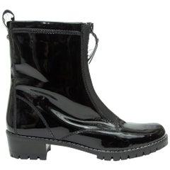 Stuart Weitzman Black Patent Shearling-Lined Boots