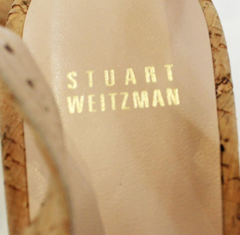 Stuart Weitzman Decoslinky cork wedge shoes on the uppers and the wedge heels are lined in beige leather.  It includes adjustable buckle slingback strap.  These wedges contain 2 3/4