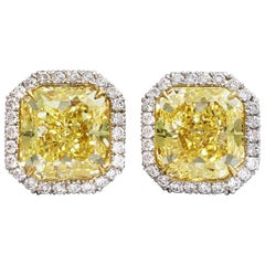 Stud Earrings with 5 carat Fancy Intense Yellow Diamonds in Platinum GIA