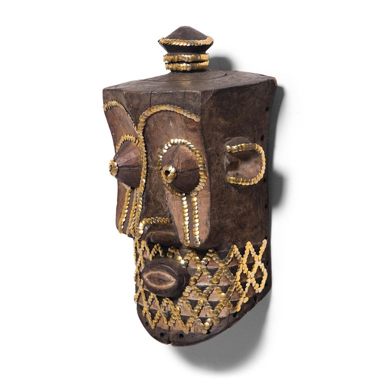 In an exclusive collaboration with PAGODA RED, Chicago artist the bms. adds a contemporary twist to our collection of one-of-a-kind African art objects. Embellishing with silver and gold thumbtacks, the bms. accentuates the sculptural form of this