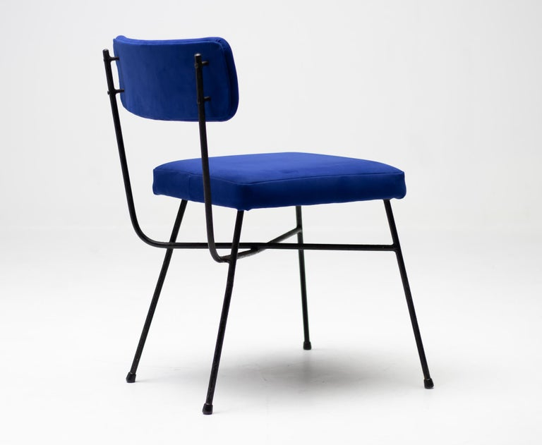 Pair of Elettra chairs created by Studio BBPR, produced by Arflex, Italy, 1954.  Structure in black lacquered solid steel rod, seat and back covered in Yves Klein Blue Alcantara.  The Italian studio BBPR was formed in 1932 by the architects, city