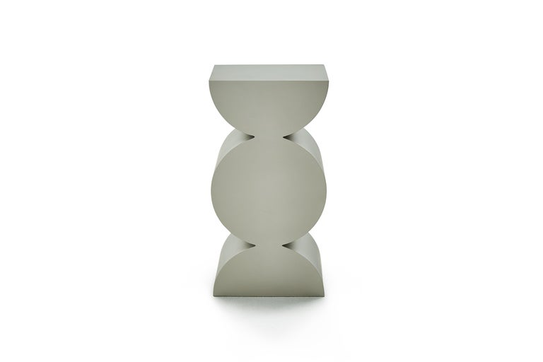 This sculptural side table is from the Studio Brancusi collection designed and made by China-based artist Danjie Yan. The works debutted at Sifang Art Museum at Nanjing, China.  Danjie was inspired by the Pioneer of modern sculpture Constantin