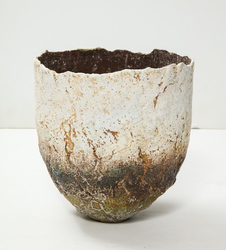 Wheel thrown stoneware vessel. Conical shape with fantastic glazes and texture resembling the bark of a tree.