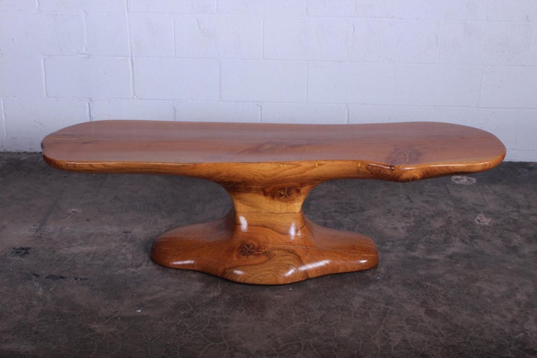 A studio craft bench or coffee table in the style of Wendell Castle.