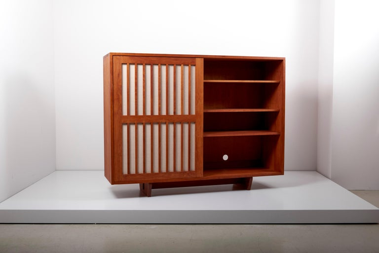 Wooden studio craft cabinet designed by Arden Riddle. This cabinet is made in American cherry.