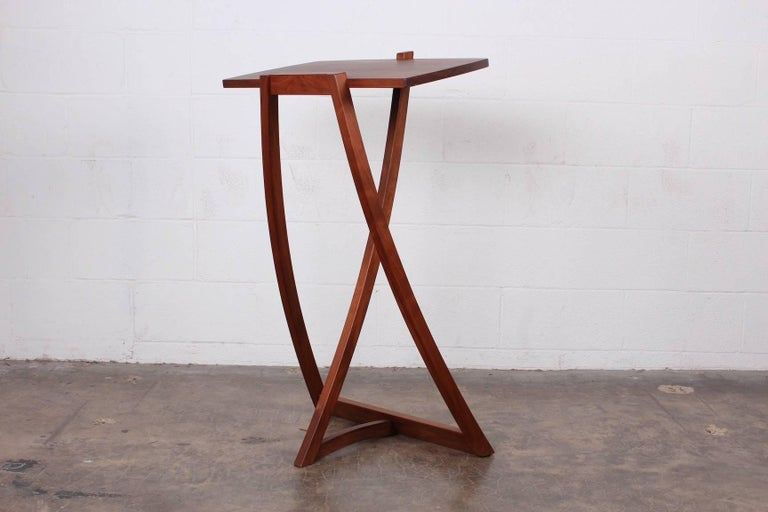 A walnut studio craft lectern / music stand.