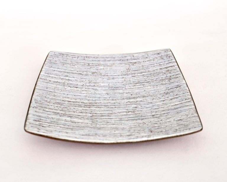 Studio Del Campo Italian white enamel, silver leaf on copper enamel over fine silver leaf slightly curved dish or vide poche. Signed Del Campo although hard to photograph the signature it is indeed there. Amazing excellent condition. No issues.