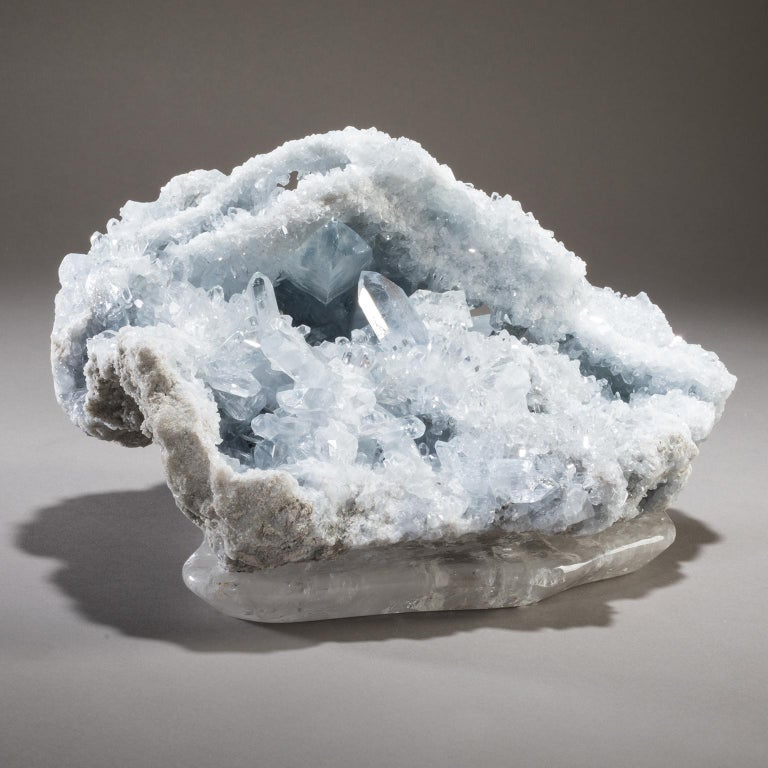 Celestite on Crystal base  On a small island, just off Ohio, in the middle of Lake Erie, a German immigrant founded a winery in 1857. While digging a well, he discovered a cave 40 feet below the surface, where ethereal blue crystals shimmered from