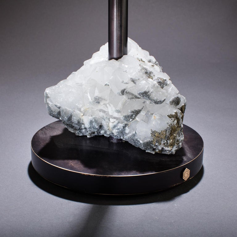 Havana Table 5  The wisdom of the gods meets the will of man in Studio Greytak's Havana Table 5. Each prism within the frosted mountain of translucent quartz crystal at the base points skyward, drawing energy and guidance from the spiritual realm,
