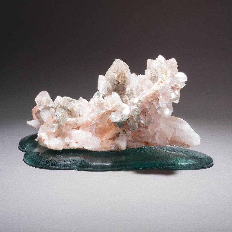 Himalayan Quartz on cast glass  Studio Greytak's Himalayan Quartz on cast glass calls to mind the dramatic geologic processes that created the Himalayas 50 million years ago. As if rising from the oceans themselves the crystal points climb from
