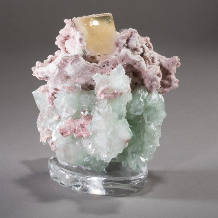 STILBITE, CALCITE, AND APOPHYLLITE ON CRYSTAL BASE  Studio Greytak's Stilbite, Calcite, and Apophyllite on Crystal Base is a trio of Norse matronae, mythical goddesses sent to provide comfort, protection, and peace. A soft bed of blue apophyllite