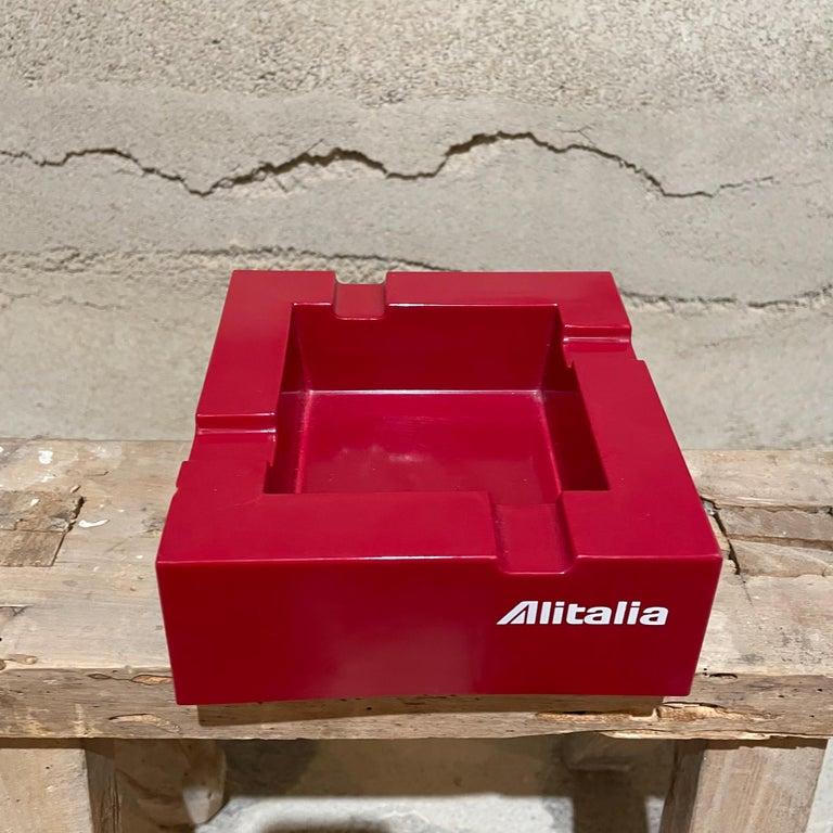 Modern vintage redAlitalia ashtrayItaly studio Joe Colombo for Alitalia Airlines, 1970s Made in plastic Red with White logo Alitalia, modern Industrial design Measures: 6.75D x 6.75W x 2.63H Stamped ALITALIA, Crippa, Milano Italy. Original