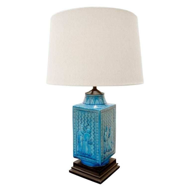 Studio made ceramic table lamp with deep blue glaze and Chinese motifs, American, 1950s.  Measure: Shade diameter 14 inches.