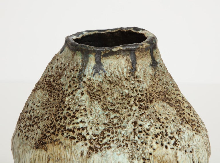 Bulbous form vase on central foot with great texture and pale glazes. Hand-built stoneware, signed and dated on underside.