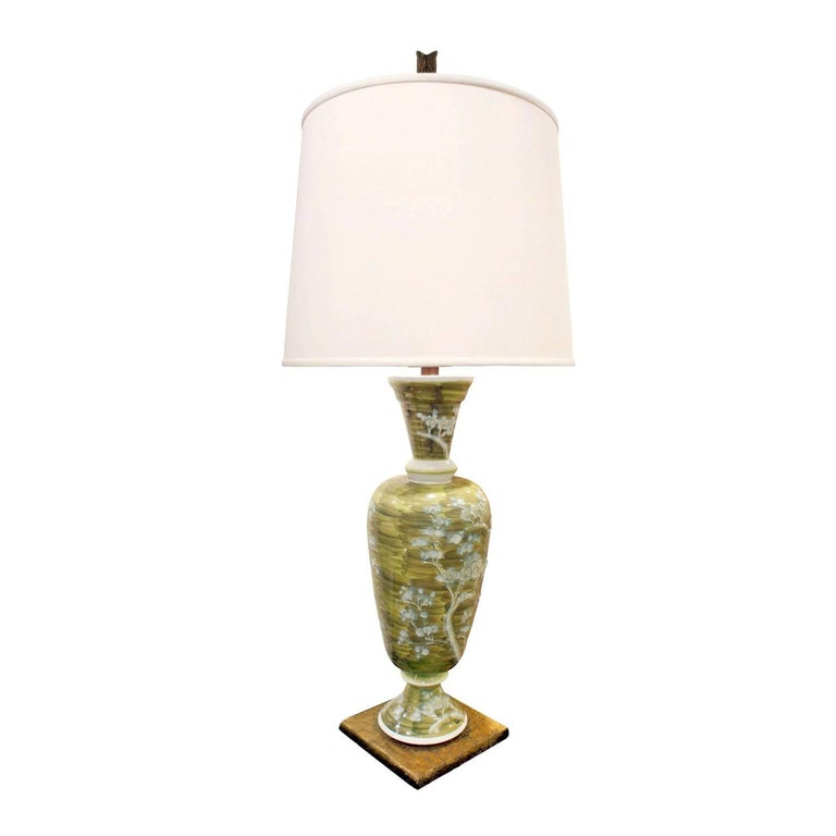 Studio made sage green porcelain table lamp with hand-painted blue flowers, on a gilded base, French, 1950s.