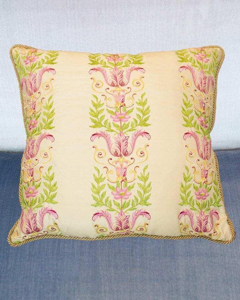 A large Studio Maison Nurita handmade pillow with green and pink embroidery on crème silk, backed in a green cotton velvet with gold metallic rope, down filled.