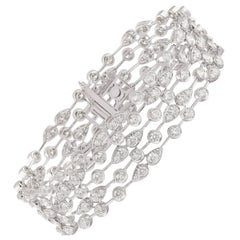 Studio Rêves 10.3 Cts Modified Brilliant cut Diamond Tennis Bracelet in 14K Gold
