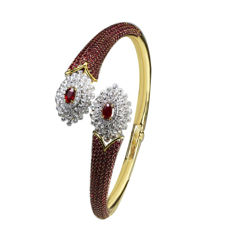Ruby and diamond bracelet  The combination of 18K white and yellow gold along with rubies and diamonds is what gives this bracelet a slightly traditional feel, adding to its charm. Generously encrusted round rose cut and round brilliant cut diamonds