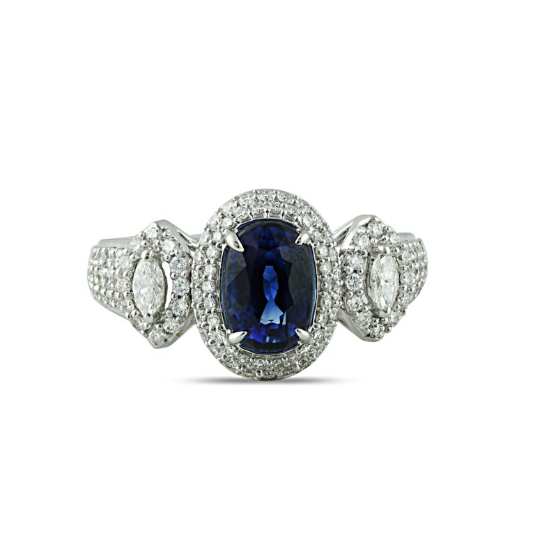 Blue sapphire and diamond ring  A classic style is given a modern twist in this 18K white gold ring studded with blue sapphire and marquise brilliant and round brilliant cut diamonds set in a prong setting. Featuring 123 stones, this ring will