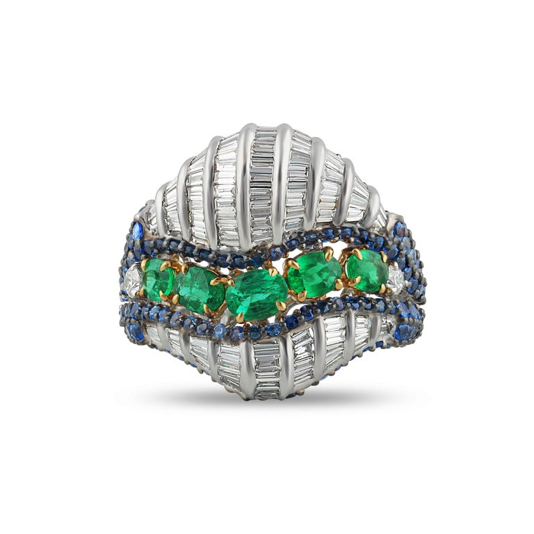 Diamond, Emerald and Blue Sapphire Ring  This 18K white and yellow gold statement ring captures the essence of nature and its calming colours. Featuring 226 emeralds, blue sapphires and diamonds of the highest quality in an intricate prong and