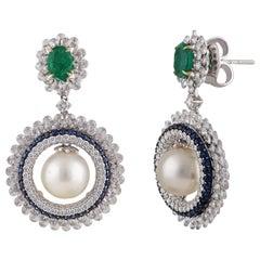 Studio Rêves Circular Earrings of Diamonds and Blue Sapphires in 18 Karat Gold