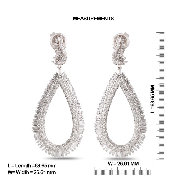 Gross Weight: 24.67 Grams Diamond Weight: 6.40 cts IGI Certification can be done on request.  Video can be uploaded on request.  Shine bright with these elegant big danglers, studded with baguettes and round brilliant cut diamonds in 18 karat gold.
