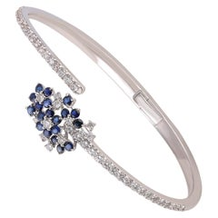 Studio Rêves Diamond and Blue Sapphire Cluster Spring Bracelet in 18 Karat Gold