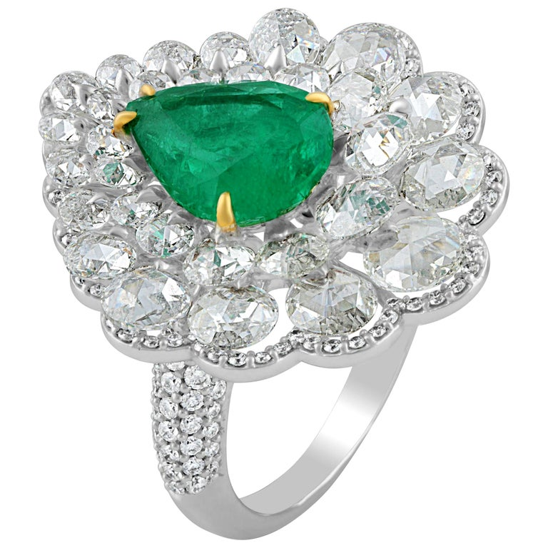 Diamond, emerald and 18-karat gold cluster ring