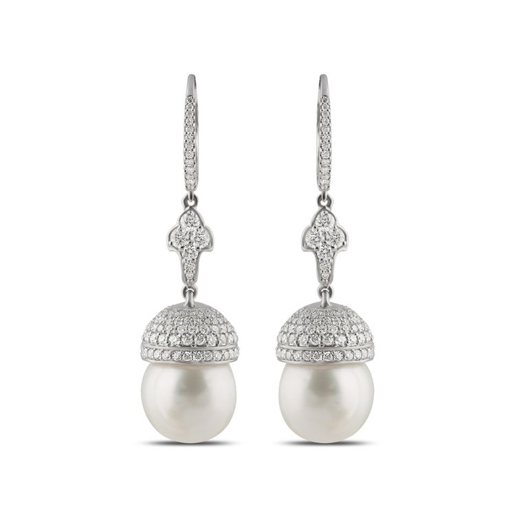 Diamond and South Sea Pearls Earrings  Feminine and classy, this pair of 18K white gold earrings featuring round brilliant cut diamonds and south sea pearls in a pavé setting is the modern connoisseur's must-have piece. This elegant pair promises to