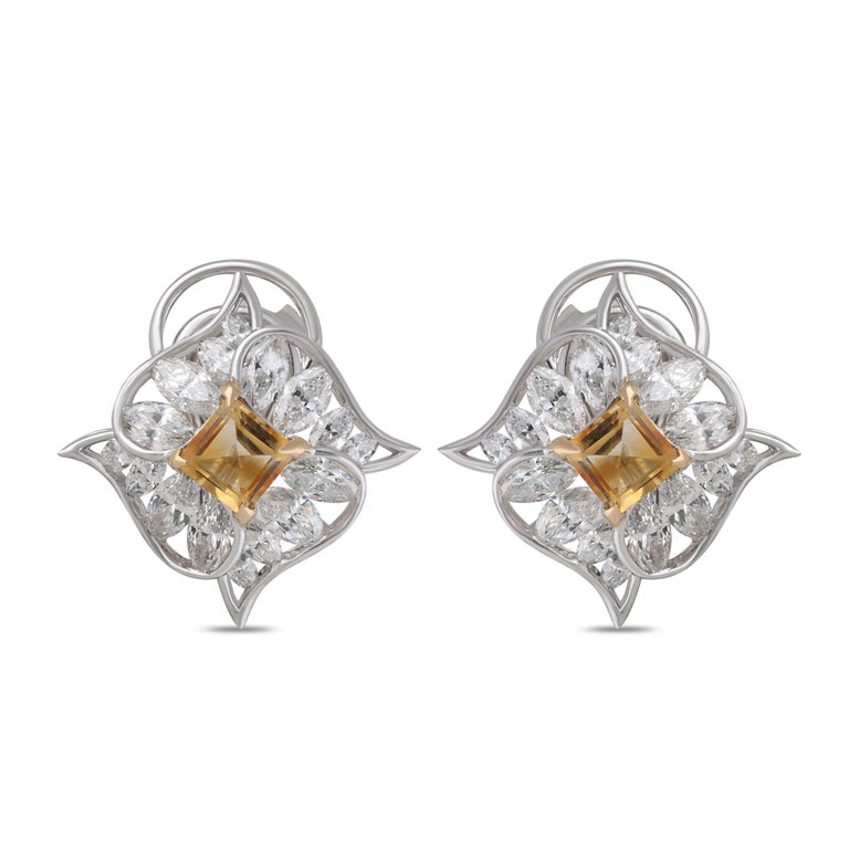 At the center of these studs a princess cut citrine is set at an angle, tipped with 18 karat yellow gold. Below it, four quadrants of white gold are studded with marquise cut diamonds. Smooth curves contrasted with pointed tips gives these classic