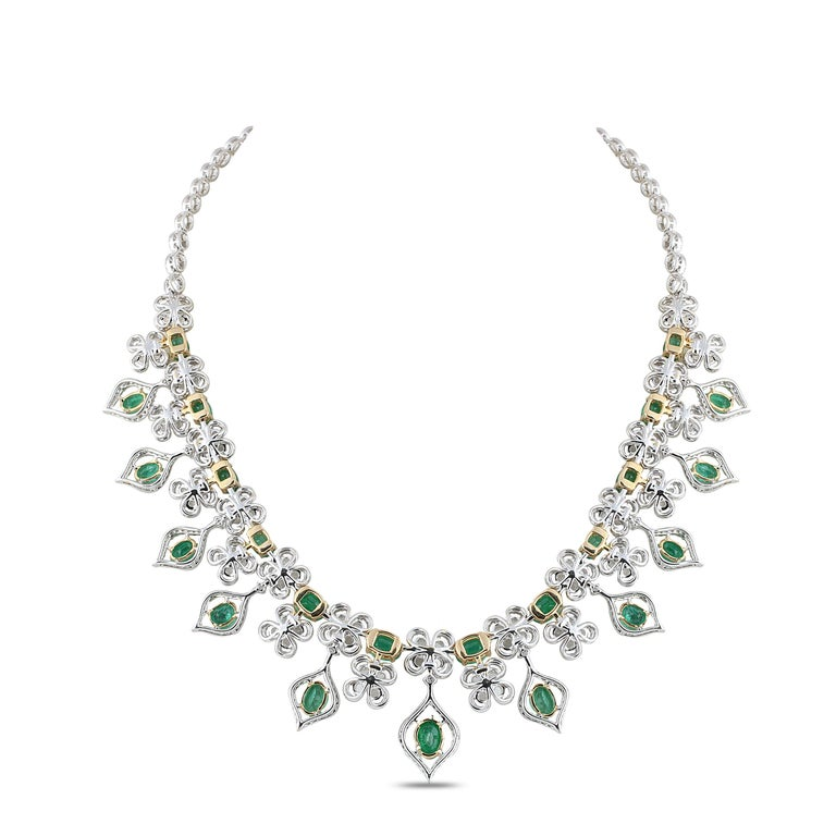 A resplendent design that's bound to make head turns can be found in this ultra-luxe 18K white and yellow gold necklace featuring round rose cut and round brilliant cut diamonds and emeralds in a prong setting. The Victorian-era design adorned with